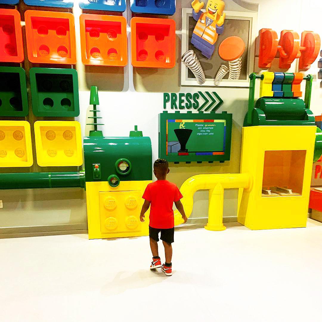 Legoland boy looking at wall