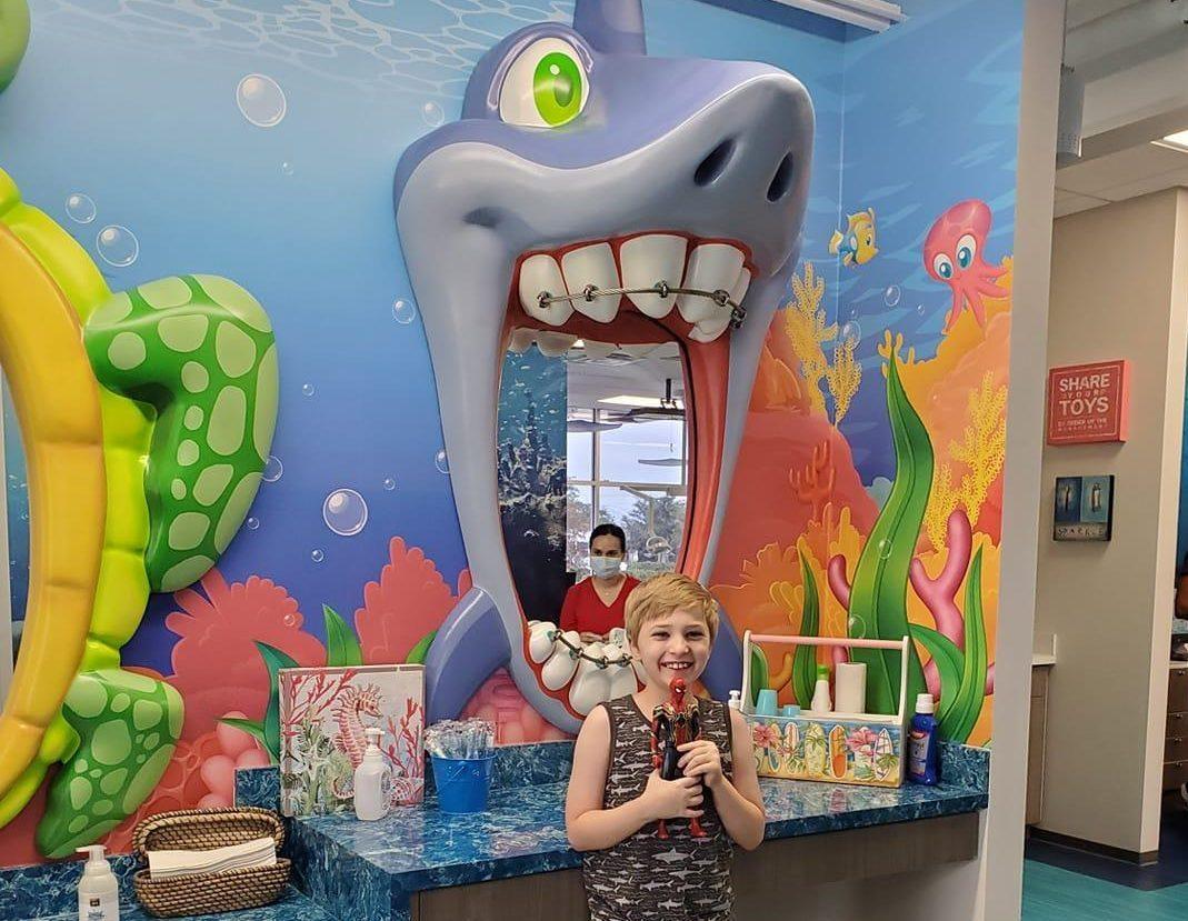 Grand Parkway Pediatric Dental shark mirror and child